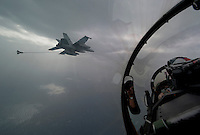 120225-N-DR144-875 ARABIAN GULF (Feb. 25, 2012) Lt. Michael Loringer, a pilot assigned to Strike Fighter Squadron (VFA) 22, repositions his F/A-18F Super Hornet after receiving fuel from an F/A-18E Super Hornet assigned to Strike Fighter Squadron (VFA) 81, flown by Cmdr. Michael River during a mission flown from the Nimitz-class aircraft carrier USS Carl Vinson (CVN 70). Carl Vinson and Carrier Air Wing (CVW) 17 are deployed to the U.S. 5th Fleet area of responsibility.  (U.S. Navy photo by Mass Communication Specialist 2nd Class James R. Evans/Released)