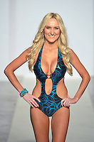 Wet Couture Swimwear by Angelina Petraglia Fashion Show Model, Annie Karns, at Funkshion Fashion Week Miami Beach 2012 at The Moore Building on March 16, 2012