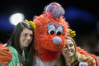 "Winston-Salem Dash mascot ""Bolt"" poses for a photo with two fans during the Carolina League game against the Frederick Keys at BB&T Ballpark on May 24, 2016 in Winston-Salem, North Carolina.  The Keys defeated the Dash 7-1.  (Brian Westerholt/Four Seam Images)"
