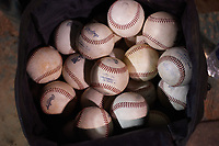 A bag of baseballs in the dugout during a California League game between the San Jose Giants and the Visalia Rawhide on April 12, 2019 at San Jose Municipal Stadium in San Jose, California. Visalia defeated San Jose 6-2. (Zachary Lucy/Four Seam Images)