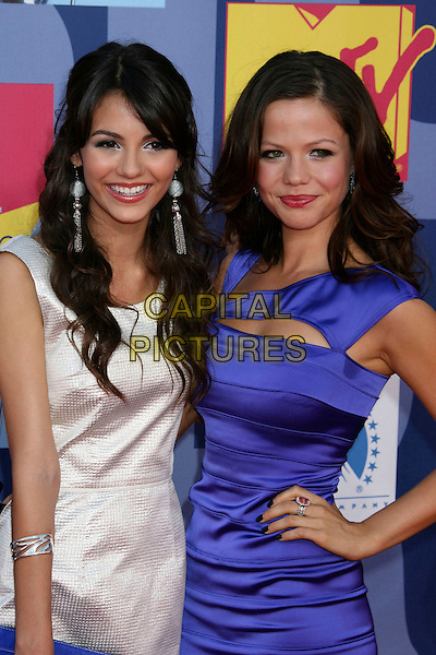 VICTORIA JUSTICE & TAMMIN SURSUK.2008 MTV Video Music Awards held at Paramount Studios, Hollywood, California, USA..September 7th, 2008.VMA Vmas arrivals half length white purple silk satin dress hand on hip dangling silver earrings .CAP/ADM/MJ.©Michael Jade/AdMedia/Capital Pictures.