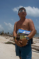 Quintana Roo, Mexico. Thursday, August 23, 2007. Yama Saad-Zoi, dive center manager of Mahahual, carries groceries on his way to his destroyed diving center was hardest hit when the category 5 Hurricane Dean made landfall in Mexico with 300km/h winds.