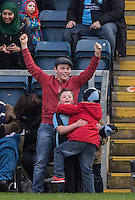Young Wycombe supporters celebrate the teams goal during the Sky Bet League 2 match between Wycombe Wanderers and Stevenage at Adams Park, High Wycombe, England on 12 March 2016. Photo by Andy Rowland/PRiME Media Images.
