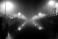 milano, il naviglio grande di notte con la nebbia --- milan, naviglio grande channel at night with fog