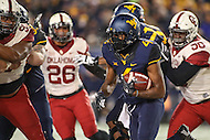 Morgantown, WV - November 19, 2016: West Virginia Mountaineers running back Kennedy McKoy (4) runs the ball during game between Oklahoma and WVU at  Mountaineer Field at Milan Puskar Stadium in Morgantown, WV.  (Photo by Elliott Brown/Media Images International)