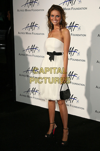 HEIDI MUELLER.3rd Annual Alfred Mann Foundation Innovation and Inspiration Gala Honoring Richard and Nancy Riordan. .Beverly Hills, California, USA,.9 September 2006..full length strapless white dress black bow.Ref: ADM/BP.www.capitalpictures.com.sales@capitalpictures.com.©Byron Purvis/AdMedia/Capital Pictures.