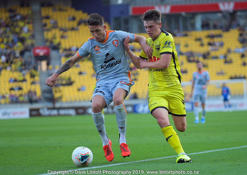 Brisbane's Scott Neville and Phoenix's Callum McCowatt compete for the ball during the A-League football match between Wellington Phoenix and Brisbane Roar at Westpac Stadium in Wellington, New Zealand on Saturday, 23 November 2019. Photo: Dave Lintott / lintottphoto.co.nz