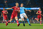 9th January 2018, Etihad Stadium, Manchester, England; Carabao Cup football, semi-final, 1st leg, Manchester City versus Bristol City; Kevin De Bruyne of Manchester City challenges for the ball with Hordur Magnusson of Bristol City