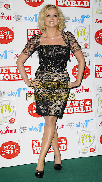 EMMA BUNTON.Children's Champions Awards 2009 at the Grosvenor House Hotel, Park Lane, London, England..March 4th 2009.full length black lace shrug caplet dress shoes platform heels layered gold beige sheer hands on hips .CAP/CAN.©Can Nguyen/Capital Pictures.