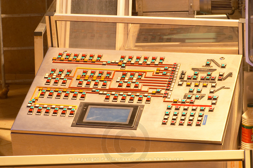 The modern control panel in the winery that oversees everything from grape reception (on the right) to pumping to delivery of the grapes and must to the fermentation tanks (to the left of the panel).  Domaine E Guigal, Ampuis, Cote Rotie, Rhone, France, Europe