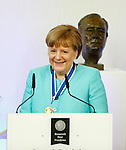 German Chancellor Angela Merkel smiles after receiving the International Four Freedoms Award at the Nieuwe Kerk in Middelburg, The Netherlands, April 21, 2016. REUTERS/Michael Kooren
