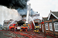 Firefighters attend a large factory fire. They use a Hydraulic Platform to aim the water directly onto the unit Oxfordshire UK. This image may only be used to portray the subject in a positive manner..©shoutpictures.com..john@shoutpictures.com