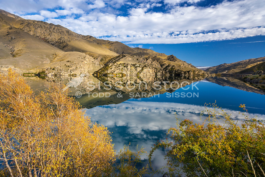 A mirror reflection of hills through the Cromwell Gorge  near the Clyde Dam, Central Otago, South Island, New Zealand - stock photo, canvas, fine art print