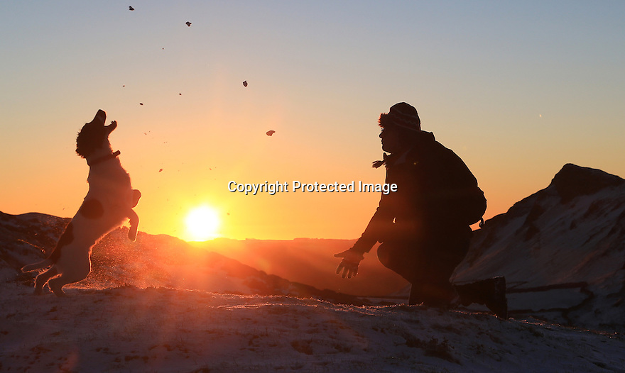 15/01/16<br /> <br /> As dawn breaks, Rod Kirkpatrick throws snowballs for his 15-month-old springer Spaniel, Chester.<br /> <br /> After a dusting of snow and sub-zero overnight temperatures, dawn breaks over Chrome Hill in the upper Dove Valley in the Derbyshire Peak District.<br /> <br /> All Rights Reserved: F Stop Press Ltd. +44(0)1335 418365   www.fstoppress.com.
