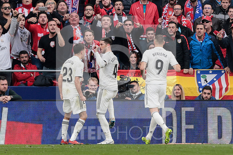 Real Madrid's Sergio Reguilon (L) and Sergio Ramos (R) celebrate goal during La Liga match between Atletico de Madrid and Real Madrid at Wanda Metropolitano Stadium in Madrid, Spain. February 09, 2019. (ALTERPHOTOS/A. Perez Meca)