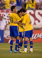 Neymar (11) of Brazil celebrates his goal with teammates Paulo Henrique Ganso and Alexandre Pato (9) during an international friendly at the New Meadowlands Stadium in East Rutherford, NJ. Brazil defeated the USMNT, 2-0.