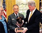 United States President Bill Clinton awards James M. Brady the Harry Yount National Park Ranger of the Year Award in the Oval Office of the White House in Washington, DC on April 23, 1997.  Mr. Brady is the Superintendent of the Glacier Bay National Park and Preserve in Alaska. Brady's wife, Gwen looks on from left.<br /> Mandatory Credit: Sharon Farmer / White House via CNP