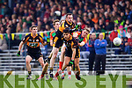 Wayne Guthrie and William Kirby Austin Stacks in action against Donnchadh Walsh Mid Kerry in the Kerry Senior County Football Final at Fitzgerald Stadium on Sunday.