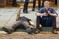 Pictured: A man lies on the pavement in Wind Street, Swansea. Monday 31 December 2018 and Tuesday 01 January 2019<br /> Re: New Year revellers in Wind Street, Swansea, Wales, UK