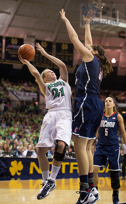 January 7, 2012; Notre Dame Fighting Irish guard Natalie Novosel goes up to shoot as Connecticut Huskies guard Stefanie Dolson defends during the second half at the Purcell Pavilion. Notre Dame won 75 to 67 in overtime. Photo by Barbara Johnston/University of Notre Dame