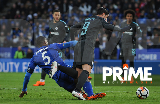 Wes Morgan of Leicester City brings down Alvaro Morata of Chelsea during the FA Cup QF match between Leicester City and Chelsea at the King Power Stadium, Leicester, England on 18 March 2018. Photo by Stephen Buckley / PRiME Media Images.