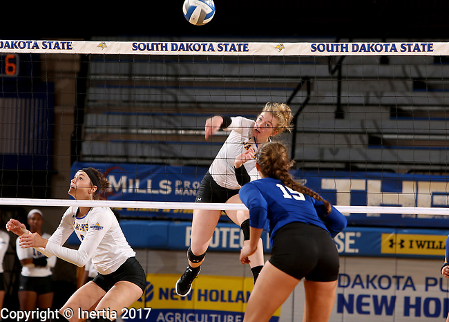 BROOKINGS, SD - SEPTEMBER 1: Makenzie Hennen #3 from South Dakota State University gets the ball over the net against Mattison DeGarmo #15 from CSU Bakersfield during their match Friday night at the Jackrabbit Invitational at Frost Arena in Brookings. (Photo by Dave Eggen/Inertia) (Photo by Dave Eggen/Inertia)