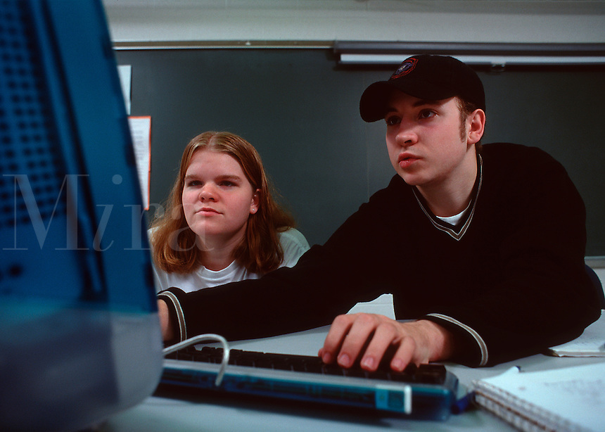 Two college students working together on a computer