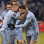 Sporting KC players Johnny Russell (left) and Ilie Sanchez celebrate after Sanchez scored against Toluca during their CONCACAF Champions League game on February 21, 2019 at Children's Mercy Park in Kansas City, KS.<br /> Tim VIZER/Agence France-Presse