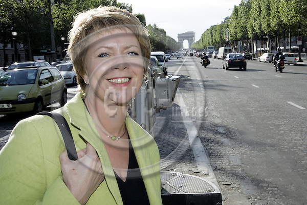 PARIS - FRANCE - 03 MAY 2005-- Åslaug HAGA, (Aslaug) the Leader of the Norwegian Centre Party (SP) walking on the Champs Elysee. -- PHOTO: JUHA ROININEN / EUP-IMAGES