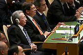 President Raul Castro of Cuba listens as United States President Barack Obama addresses the 70th annual United Nations General Assembly at the UN headquarters September 28, 2015 in New York City. Obama will hold bilateral meetings with Indian Prime Minister Narendra Modi and Russian President Vladimir Putin later in the day. <br /> Credit: Chip Somodevilla / Pool via CNP