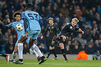 Gary Mackay-Steven of Celtic hits a shot at goal during the UEFA Champions League GROUP match between Manchester City and Celtic at the Etihad Stadium, Manchester, England on 6 December 2016. Photo by Andy Rowland.