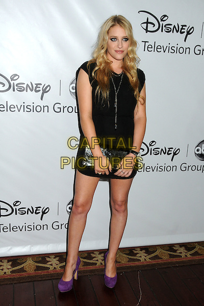 Carly Chaikin.Disney ABC 2012 TCA Winter Press Tour held at the Langham Huntington Hotel, Pasadena, California, USA..January 10th, 2012.full length black sleeveless dress purple shoes clutch bag.CAP/ADM/BP.©Byron Purvis/AdMedia/Capital Pictures.