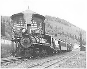 RGS 2-8-0 #74 with Rocky Mountain Railroad Club excursion train with two coaches, two gondolas and a caboose at Brown water tank.<br /> RGS  Brown, CO  5/28/1949