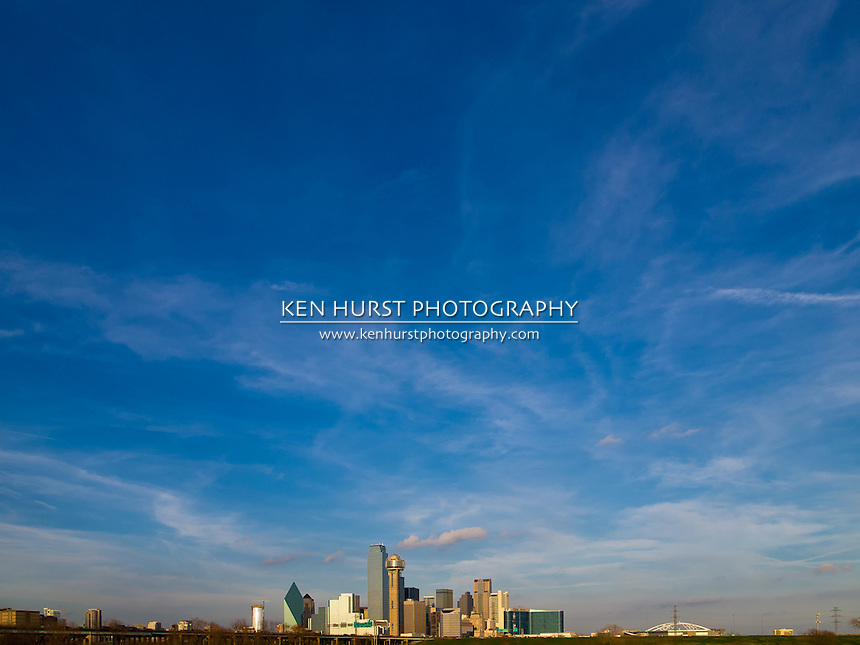The Dallas, Texas skyline with beautiful blue sky and clouds.