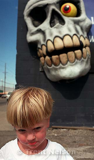 Nathaniel Nelson in front of the skull at the Institute of Terror.<br />