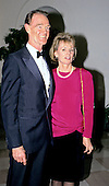 Brian G. Dyson, President and CEO, Coca-Cola Enterprises, Inc. and his wife, Penny, arrive at the White House in Washington, DC for the State Dinner honoring President Carlos Menem of Argentina on Thursday, November 14, 1991.<br /> Credit: Ron Sachs / CNP