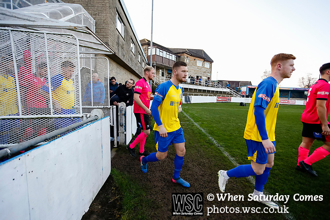 The teams enter the pitch. Stocksbridge Park Steels v Pickering Town, Evo-Stik East Division, 17th November 2018. Stocksbridge Park Steels were born from the works team of the local British Steel plant that dominates the town north of Sheffield.<br />