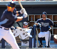 Tampa Bay Rays manager Joe Madden #70 (left) and Jeff Keppinger #7 look on as Ben Zobrist #18 bats during a spring training game against the Baltimore Orioles at the Charlotte County Sports Park on March 5, 2012 in Port Charlotte, Florida.  (Mike Janes/Four Seam Images)