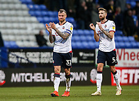 Bolton Wanderers' David Wheater and Mark Beevers applaud their supporters at the end of the match  <br /> <br /> Photographer Andrew Kearns/CameraSport<br /> <br /> The EFL Sky Bet Championship - Bolton Wanderers v Norwich City - Saturday 16th February 2019 - University of Bolton Stadium - Bolton<br /> <br /> World Copyright © 2019 CameraSport. All rights reserved. 43 Linden Ave. Countesthorpe. Leicester. England. LE8 5PG - Tel: +44 (0) 116 277 4147 - admin@camerasport.com - www.camerasport.com
