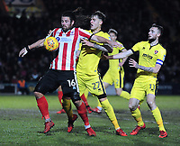 Lincoln City's Michael Bostwick shields the ball from Cheltenham Town's Joe Rodon and Carl Winchester<br /> <br /> Photographer Andrew Vaughan/CameraSport<br /> <br /> The EFL Sky Bet League Two - Lincoln City v Cheltenham Town - Tuesday 13th February 2018 - Sincil Bank - Lincoln<br /> <br /> World Copyright &copy; 2018 CameraSport. All rights reserved. 43 Linden Ave. Countesthorpe. Leicester. England. LE8 5PG - Tel: +44 (0) 116 277 4147 - admin@camerasport.com - www.camerasport.com
