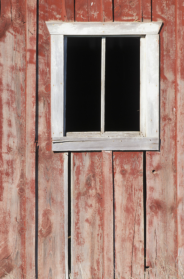 Window of old red barn, Palouse area, Washington.