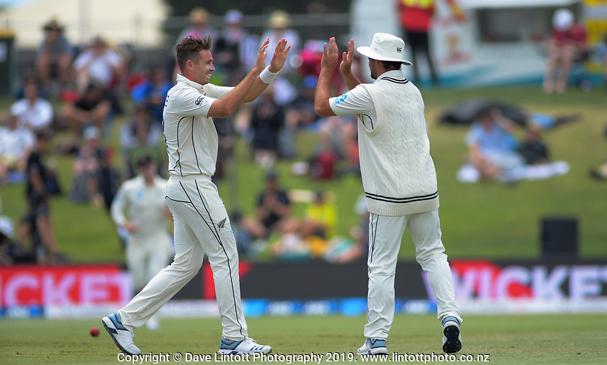 NZ's Tim Southee celebrates the dismissal of England's Ben Stokes with Colin de Grandhomme during day two of the international cricket 1st test match between NZ Black Caps and England at Bay Oval in Mount Maunganui, New Zealand on Friday, 22 November 2019. Photo: Dave Lintott / lintottphoto.co.nz