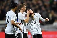 FUSSBALL INTERNATIONAL TESTSPIEL IN DER ALLIANZ ARENA MUENCHEN Deutschland - Italien    29.03.2016  Torjubel nach dem 4:0: Emre Can, Marco Reus und Mesut Oezil (v.l., alle Deutschland)
