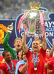 Manchester United's Nemanja Vidic lifts the FA Premier League Trophy during the Premier League match at The JJB Stadium, Wigan. Picture date 11th May 2008. Picture credit should read: Simon Bellis/Sportimage