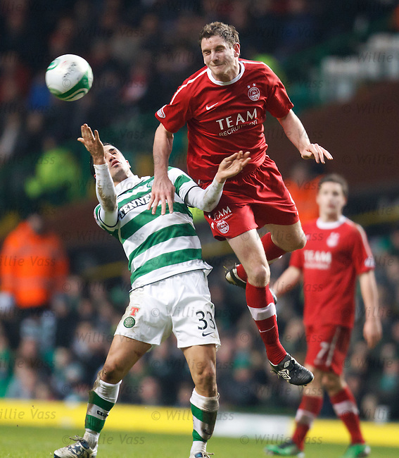 Scott Vernon beats Beram Kayal to the ball