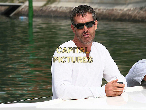 RUPERT EVERETT.64th Venice Film Festival - Mostra Internazionale d'Arte Cinematografica, Venice, Italy..August 29th, 2007.half length sunglasses shades white top stubble facial hair .CAP/OME/LG.©Luca Ghidoni/Omega/Capital Pictures