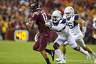 Landover, MD - September 3, 2017: West Virginia Mountaineers safety Toyous Avery (16) tackles Virginia Tech Hokies quarterback Josh Jackson (17) during game between Virginia Tech and WVA at  FedEx Field in Landover, MD.  (Photo by Elliott Brown/Media Images International)