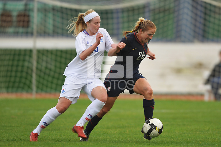 US Women's National Team defender Rachel Buehler dribbles past an Icelandic defender during at game at Vila Real Sto. Antonio at the 2010 Algarve Cup in Portugal.