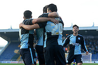 Wycombe Wanderers Luke O'Nien celebrates with team mates Paul Hayes and Sam Wood after putting the visitors 1-0 ahead during the Sky Bet League 2 match between Mansfield Town and Wycombe Wanderers at the One Call Stadium, Mansfield, England on 31 October 2015. Photo by Garry Griffiths.