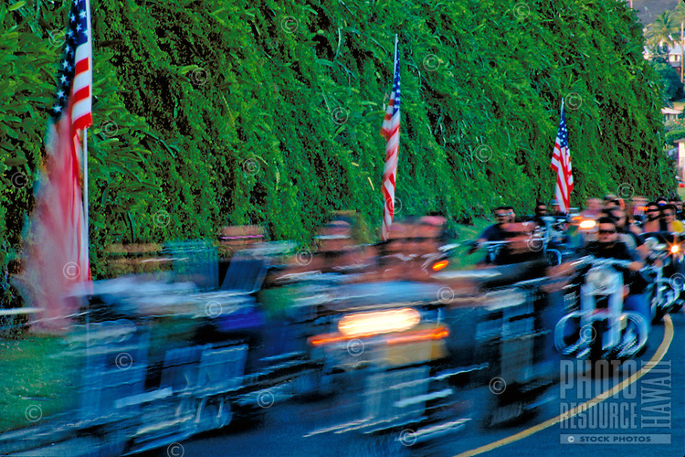 Veterns on motorcylces on memorial day near Punchbowl cemetry, Oahu with blurred long exposure
